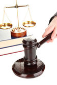 Judge's gavel in hand isolated on white — Stock Photo