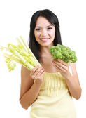 Girl with fresh broccoli and celery isolated on white — Stock Photo