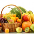 Stock Photo: Assortment of exotic fruits and berries in baskets isolated on white