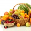 Assortment of exotic fruits and berries in baskets isolated on white — Stock Photo #28301511