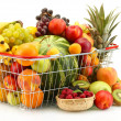 Stock Photo: Assortment of exotic fruits in metal basket and berries isolated on white