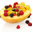 Fresh fruits salad in melon  and berries, isolated on white — Stock Photo