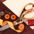 Sewing accessories and fabric close-up — Стоковая фотография