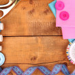 Sewing accessories and fabric on wooden table close-up — Стоковая фотография