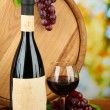 Composition of wine, wooden barrel and grape, on bright background — Stock Photo #28302709