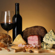 Exquisite still life of wine, cheese and meat products — Stock Photo #28302891