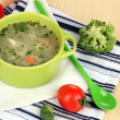 Diet soup with vegetables in pon wooden table close-up — Stock Photo #28303069