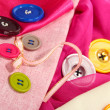 Stock Photo: Mane buttons on bright cloth