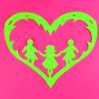 Green cut out paper heart with people inside, on color background — Stock Photo #28303313