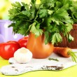 Fresh herb in pitcher on wooden table on natural background — Stock Photo #28306611