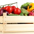 Fresh vegetables in wooden boxes on white background — Stock Photo #28308645