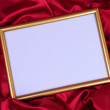 Empty frame on beautiful silk background — Stockfoto