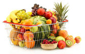 Assortment of exotic fruits in metal basket and berries isolated on white — Stock Photo