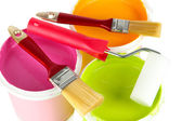Set for painting: paint pots, brushes, paint-roller close up — 图库照片