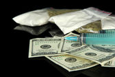 Drugs, money and syringes, isolated on black — Stock Photo