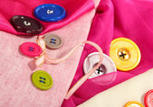 Mane buttons on bright cloth — Stock Photo