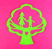 Green cut out paper tree with people inside, on color background — Stock Photo