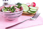 Vitamin vegetable salad in bowl with ingredients isolated on white — Stock Photo