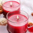 Beautiful red candles with flower petals in water — Stock Photo #28314973
