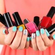 Woman hands with nail polishes, close-up — Stock Photo #28315215