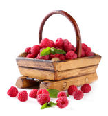 Ripe sweet raspberries in wooden basket, isolated on white — Stock Photo