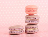Gentle macaroons on pink background — Stock Photo
