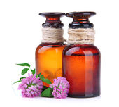 Medicine bottles with clover flowers, isolated on white — Stock Photo