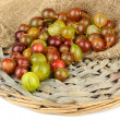 Stock Photo: Fresh gooseberries on wicker mat close-up