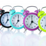 Colorful alarm clock isolated on white — Stock Photo