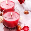 Beautiful red candles with flower petals in water — Stock Photo #28377389
