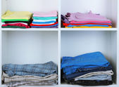 Clothes neatly folded on shelves — Stock Photo