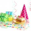 Colorful birthday cake with candle and gifts isolated on white — Stock Photo