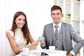 Business partners changing business cards in cafe — Stock Photo