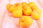 Fresh natural apricot on wooden table — Stock Photo
