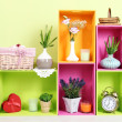 Shelves of different bright colors with decorative addition on wall background — Stock Photo #28506035