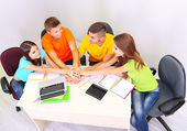 Group of young students sitting in the room — Stock Photo