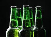 Bottles of beer on black background — Stock Photo
