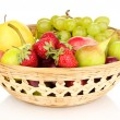 Stock Photo: Mix of ripe sweet fruits and berries in basket isolated on white