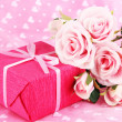 Romantic parcel on pink cloth background — Stock Photo