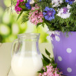 Beautiful bouquet in pail on wooden table on natural background — Stock Photo #28527639