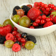 Stock Photo: Ripe berries in bowl on table close-up
