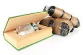Narcotics in book-hiding place and packages isolated on white — Stock Photo