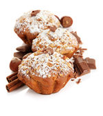 Tasty muffin cakes with powdered sugar and chocolate, isolated on white — Stock Photo