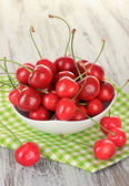 Cherry berries on wooden table close up — Stock Photo