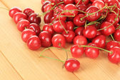 Cherry berries on wooden table — Stock Photo