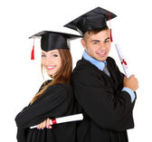 Two happy graduating students isolated on white — Stock Photo