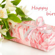 Gift-box and flowers isolated on white — Stock Photo