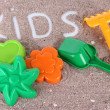 Various children's toys on sand — Stock Photo #28531999