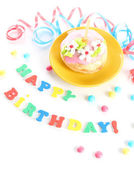 Colorful birthday cake with candle isolated on white — Stock Photo