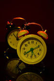 Two old style alarm clocks on dark color background — Stock Photo